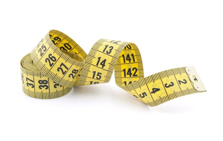 measure waist: Tailor measuring tape with soft shadow Stock Photo