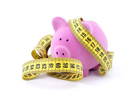 Piggy bank with measure tape Stock Photo