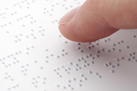 braille: Lectura de Braille Foto de archivo