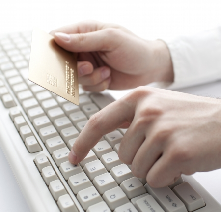 online transaction: Paying with gold credit card. Shallow DOF
