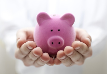 money box: Man holding piggy bank. Shallow DOF Stock Photo