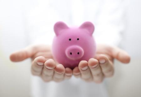white piggy bank: Man holding piggy bank. Shallow DOF Stock Photo