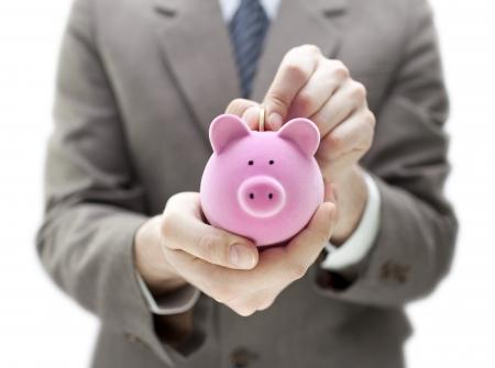 cuenta bancaria: Empresario poner monedas en la hucha