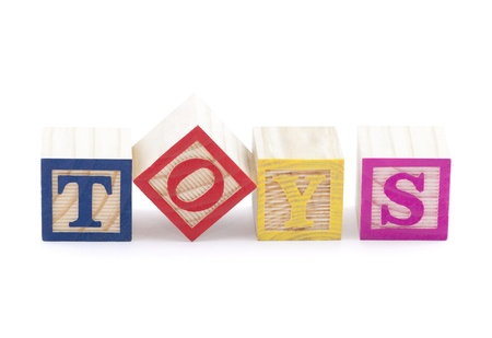 Alphabet blocks spelling the word toys with clipping path photo