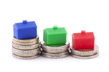 Euro coins and houses photo