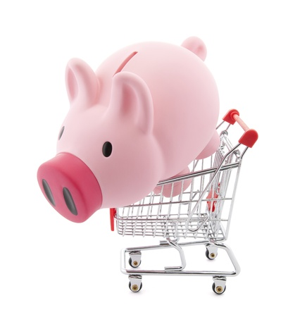 Piggy bank with shopping cart. Clipping path included photo