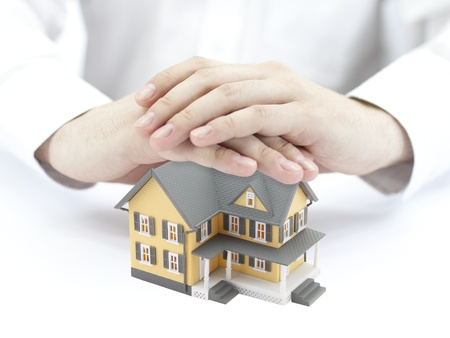 Hands and little yellow house Stock Photo - 10141843