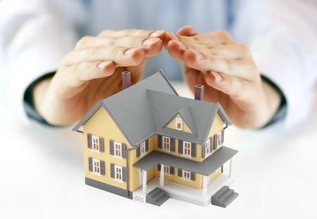 home insurance: Hands and house model