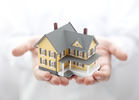 buy house: Yellow house in hands