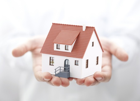 hand holding house: House in hands Stock Photo