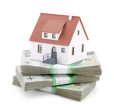 House on stack of polish zlotys