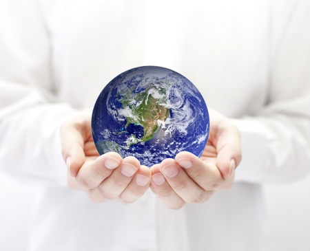 human geography: Earth in hands Stock Photo