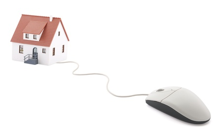 Small house connected to computer mouse photo