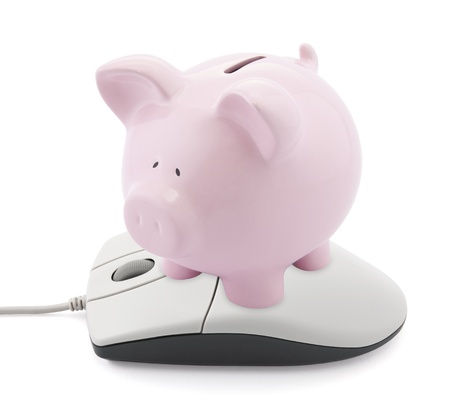 Online banking. Piggy bank and computer mouse photo