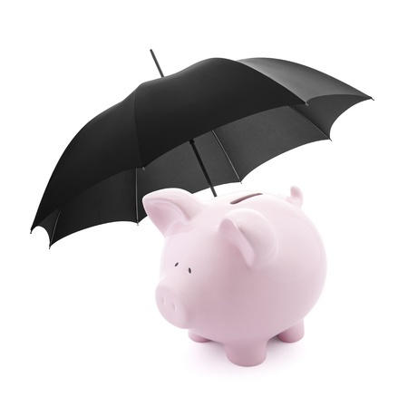 bank protection: Financial insurance. Piggy bank with umbrella Stock Photo