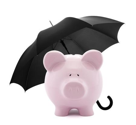 piggy bank: Financial insurance. Piggy bank with umbrella Stock Photo