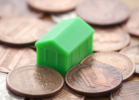 Miniature green house on US coins photo