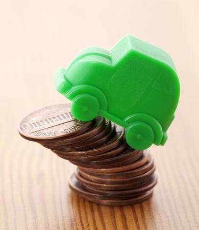 pennies: Green car miniature over pennies
