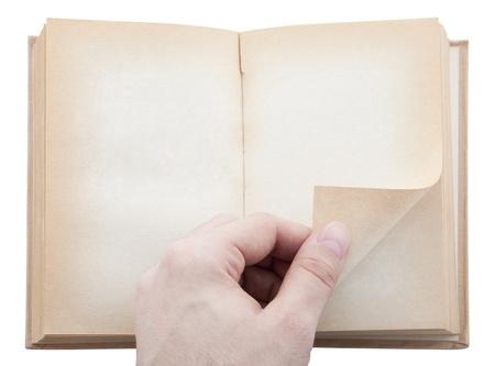 Mano y la página viejo libro en blanco