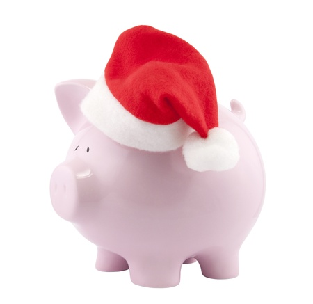 christmas savings: Piggy bank with Santa Claus hat. Clipping path included. Stock Photo