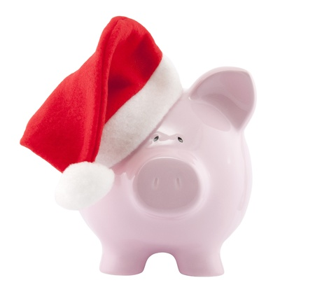 Piggy bank with Santa Claus hat. Clipping path included. Stock Photo - 11190671