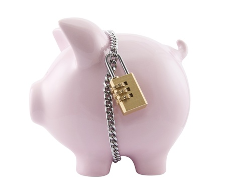 secured: Piggy bank secured with padlock. Clipping path included. Stock Photo