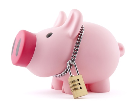 money box: Piggy bank secured with padlock. Clipping path included. Stock Photo