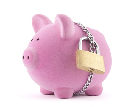 bank protection: Piggy bank secured with padlock. Clipping path included. Stock Photo