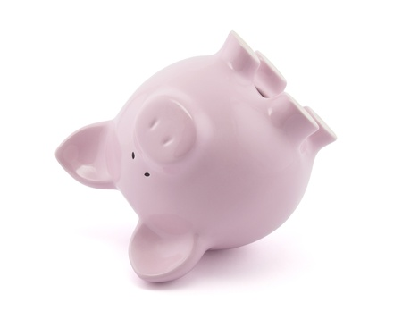 Pink piggy bank upside down. Clipping path included. photo