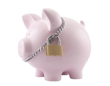 Piggy bank secured with padlock. Clipping path included. photo