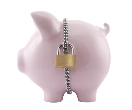 Piggy bank secured with padlock. Clipping path included. Stock Photo - 11190667