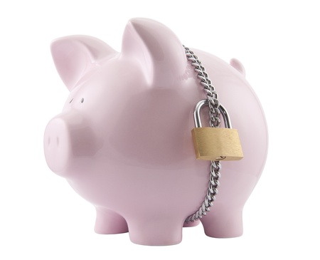 bank economic crisis: Piggy bank secured with padlock. Clipping path included. Stock Photo