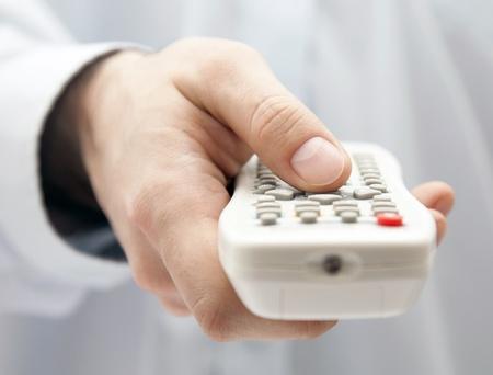 tv remote: Tv remote control in hand