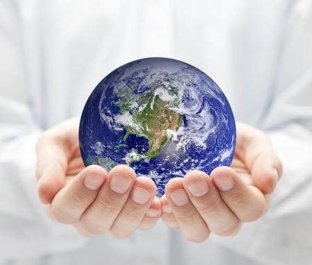 mundo manos: La tierra en manos de