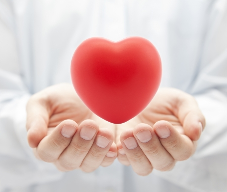 hands holding heart: Health insurance or love concept Stock Photo