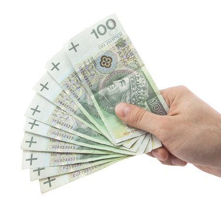Polish money in hand. Clipping path included. Imagens