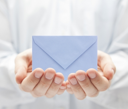 email envelope: Blue paper envelope in hands Stock Photo