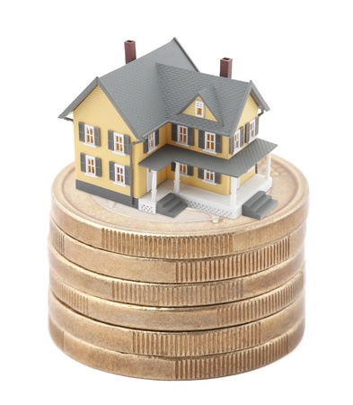 House on stack of euro coins Stock Photo