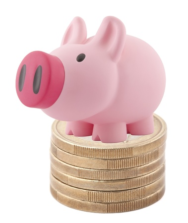 Piggy bank standing on stack of euro coins photo