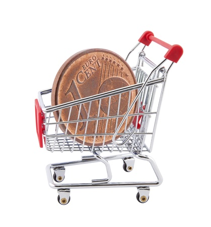 Shopping cart with euro cent coin on white background photo