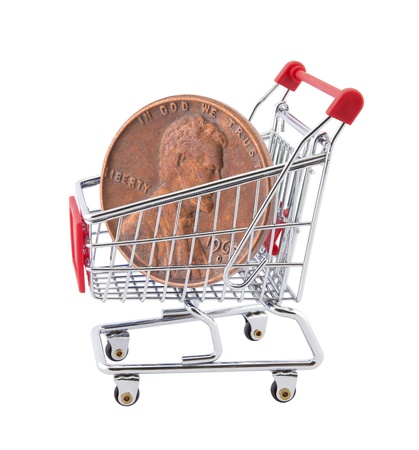 Shopping cart with penny on white background photo