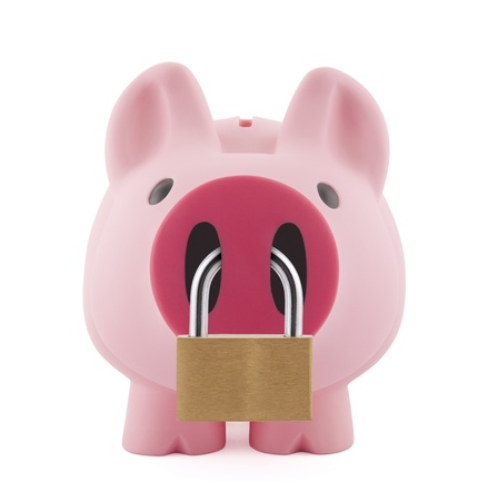 Piggy bank secured with padlock Stock Photo - 12105762