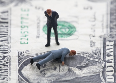 Financial crisis. Figure of businessman on one dollar bill photo