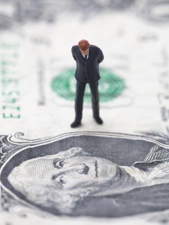Figure of businessman on one dollar bill photo