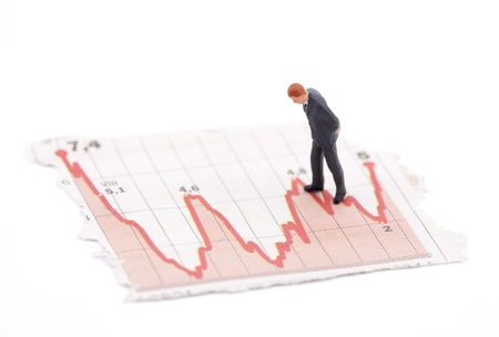 forecasts: Financial crisis. Figure of businessman on financial charts