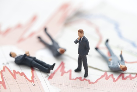 forecasts: Financial crisis. Figures of businessman on financial charts