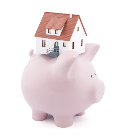 Piggy bank with small model house photo