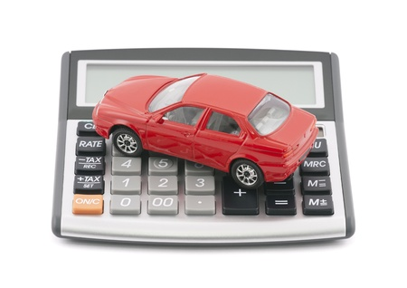 Calculator and red toy car with clipping path photo