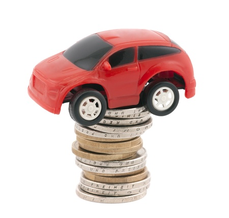 Red toy car on stack of euro coins photo
