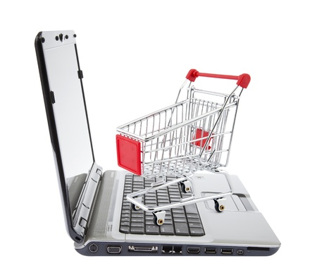 e auction: Online shopping  Shopping cart with laptop on white  Stock Photo